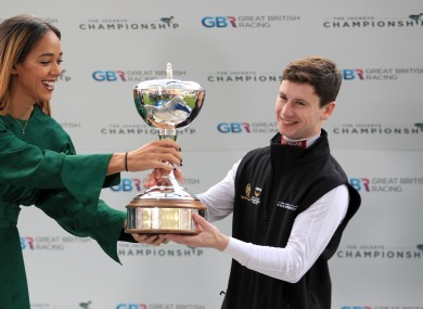 Oisin Murphy is crowned Champion Jockey by athlete Katarina Johnson-Thompson during QIPCO British Champions Day at Ascot Racecourse.