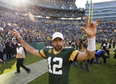 Man, myth, legend: Aaron Rodgers celebrates a career-best passing performance.