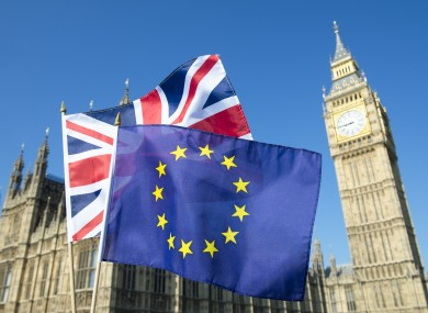 File photo of British and EU flags flying in front of Big Ben and the Houses of Parliament in London.