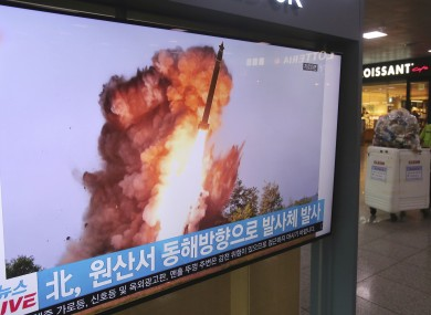 A TV screen at Seoul Railway Station shows a file image of a North Korean missile launch yesterday.