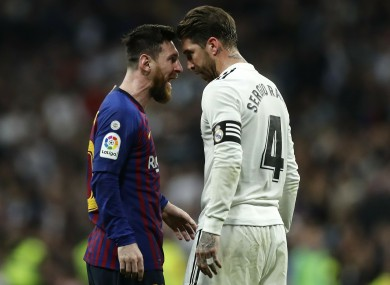 Leo Messi and Sergio Ramos square up during last season's meeting.