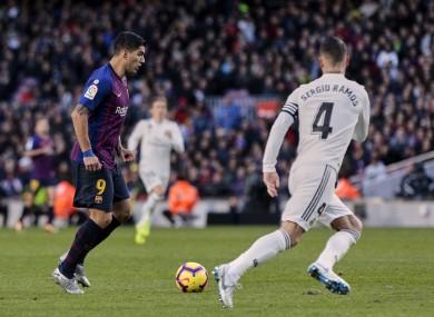 Barca striker Luis Suarez and Real Madrid captain Sergio Ramos.