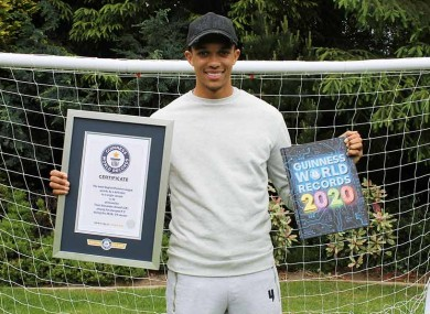 Holding his certificate and a copy of the 2020 edition of the book.