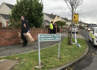 Gardaí remove evidence from the scene.