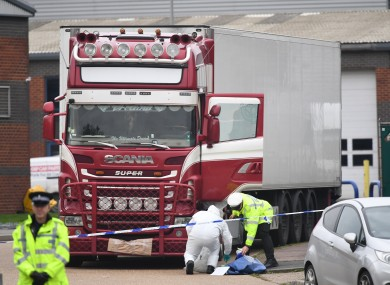 Police examine the truck where 39 migrants were found dead in Grays, Essex last week