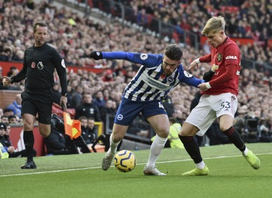 Aaron Connolly holding off Manchester United defender Brandon Williams.