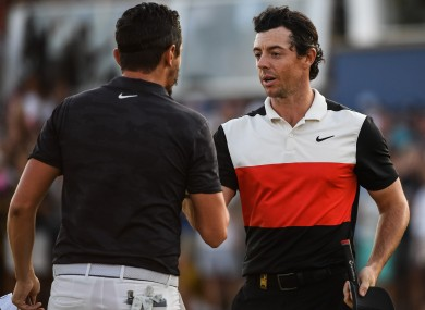 Rory McIlroy shakes hands with Mike Lorenzo-Vera after finishing on the 18th green in round two of the DP World Tour Championship in Dubai.