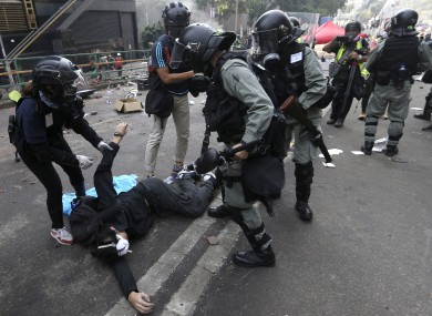 Riot police detain a protester at Hong Kong Polytechnic University this week.
