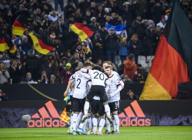 Germany players celebrate Leon Goretzka's goal.