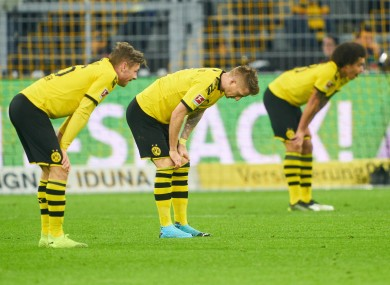 Marco Reus, Lukasz Piszczek and Axel Witsel react at full-time.