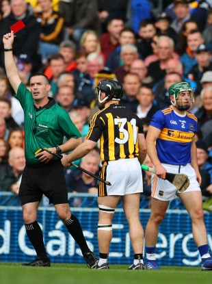 Referee James Owens shows a red card to Richie Hogan.