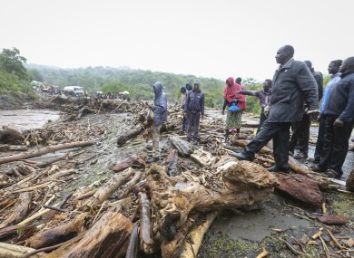 Passengers from stranded vehicles stand next to debris in Kenya