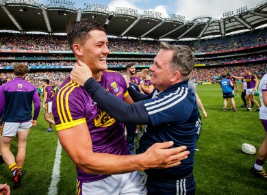 Wexford's Lee Chin celebrates with manager Davy Fitzgerald after their Leinster final success.