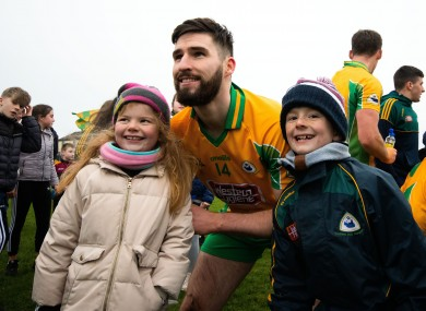 Corofin's Martin Farragher poses for a photo after their victory.