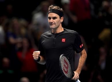 Federer celebrates winning.