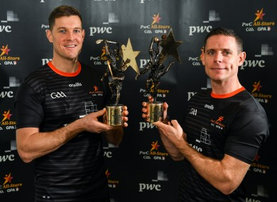 Seamus Callanan and Stephen Cluxton with their 2019 PwC Footballer and Hurler of the Year awards at the Convention Centre in Dublin.