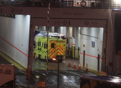 An ambulance on the ferry where 16 migrants were found alive on Thursday.