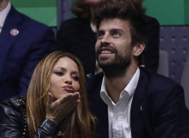 Colombian singer Shakira blows a kiss next to her husband Barcelona soccer player Gerard Pique.