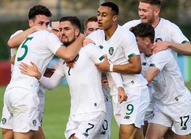 The Irish players celebrate with goalscorer Zack Elbouzedi.