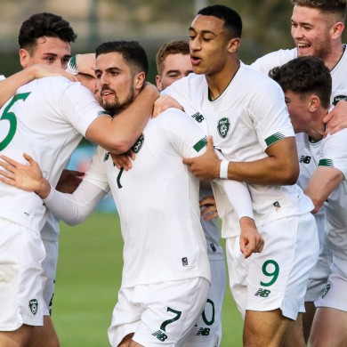 The Irish players celebrate with goalscorer Zack Elbouzedi.