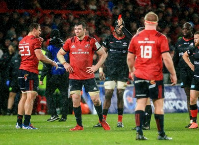 Referee Roman Poite produces a red card for Arno Botha in Munster's win against Saracens on Saturday.