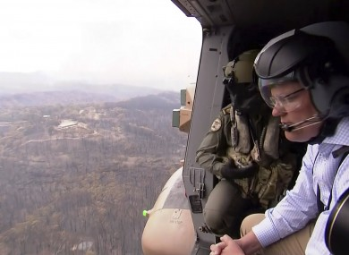 Australia's Prime Minister Scott Morrison looks out from a helicopter Gospers Mountain, New South Wales.