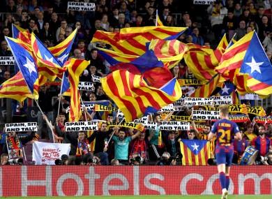 Barcelona fans wave Catalan flags.
