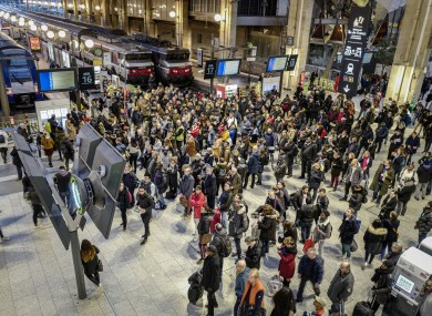 Commuters try to access metro trains at Gare du Nord train station in Paris, France