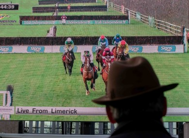Gigginstown's Eddie O'Leary watches the Limerick battle between Samcro and Faugheen on the big screens at Leopardstown.