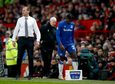 Everton's Moise Kean, a substitute himself is replaced and walks past manager Duncan Ferguson.