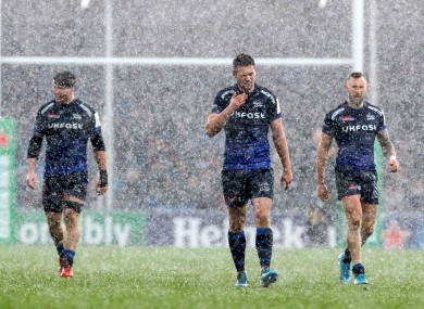 Sale players leave the pitch during a hailstorm in their game against Exeter.