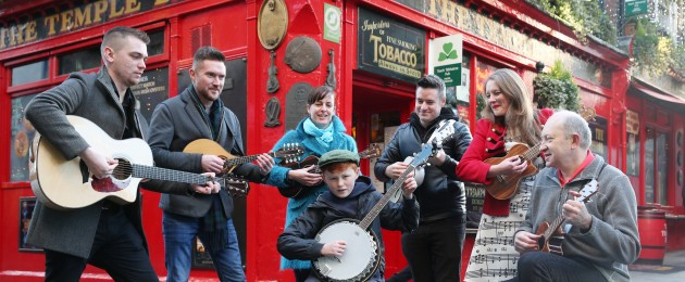 Conor Mullin (12) playing with artists from Tradfest, which runs from 22-26 January, in Temple Bar in Dublin city.