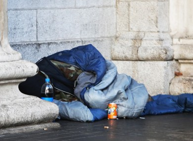 A person is pictured in a sleeping bag outside the GPO in Dublin city centre.
