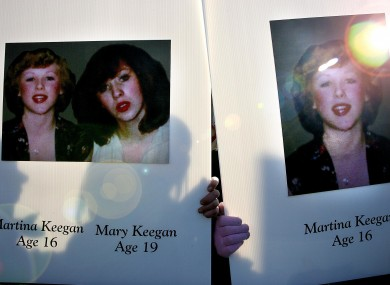 Relatives of the Keegan family hold posters of Martina and Mary Keegan, two of the victims of the Stardust Fire