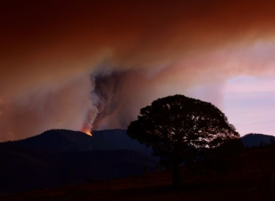 The sky over the Namadgi National Park turns red due to a bushfire in Canberra