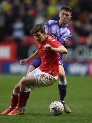 Dara O'Shea tangling with Josh Davison during West Bromwich Albion's FA Cup third-round win over Charlton Athletic.