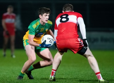 Donegal's Ethan O'Donnell with Derry's Emmett Bradley in tonight's McKenna Cup clash.