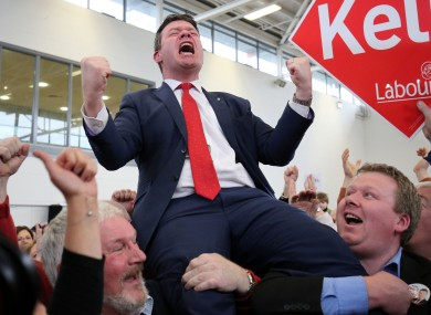 Labour candidate Alan Kelly is hoisted into the air as he celebrates being elected