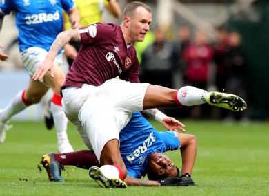 Glenn Whelan tackles Alfredo Morelos in a Scottish Premiership game earlier this season.