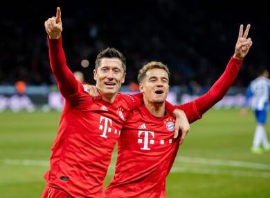 Lewandowski celebrates with team-mate Phillippe Coutinho.