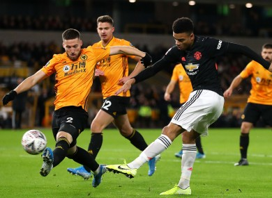Mason Greenwood gets a shot off against Wolves