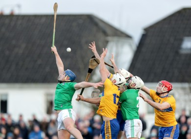 Limerick's Mike Casey and Tom Condon challenge with Aaron Shanagher, Ryan Taylor and Niall Deasy of Clare.