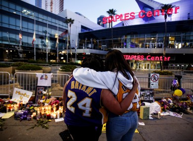 Fans pay their respects outside the LA Lakers stadium.