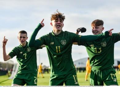 Adam Murphy (left), Kevin Zefi (centre) and Alex Nolan (right) celebrate a goal.