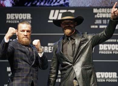 Conor McGregor and Donald 'Cowboy' Cerrone pose for photographers during a news conference for a UFC 246.