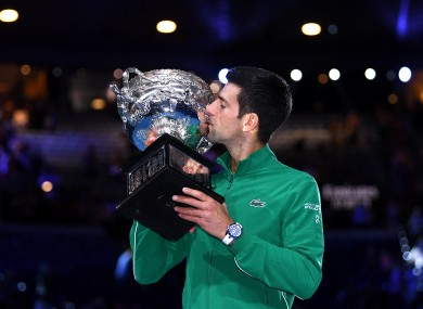 Djokovic poses for a photograph with the Norman Brookes Challenge Cup.