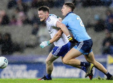 Conor McManus is tackled by Michael Fitzsimons.