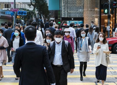 People wearing surgical masks in Central Hong Kong.