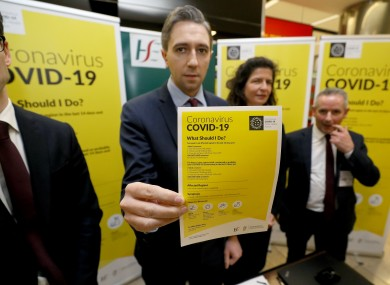 Minister for Health Simon Harris holds a leaflet which forms part of the public awareness campaign for COVID-19.