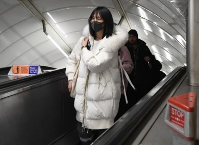A women wearing a face mask at Leicester Square tube station, London.